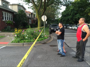 The family of Manuel Arizaga, who was shot to death while walking to work in the Irving Park neighborhood Friday morning, looks on as police investigate the crime scene. | Sam Charles/Sun-Times
