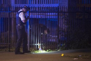 A 7-year-old boy was killed and a 26-year-old woman was injured in a shooting in the 1100 block of North Harding early Sunday, July 5, 2015. | Ashlee Rezin/Chicago Sun-Times