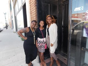 Danielle Blackwell (left) and her daughters Tashanti Blanton and Deja Blackwell stand outside the Fleetwood restaurant, where both Blackwells work. | Tristan Sims/for Homicide Watch Chicago