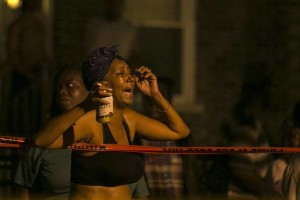 A woman reacts to a fatal shooting early Tuesday in the 300 block of West 42nd Street. | Ashlee Rezin/Chicago Sun-Times