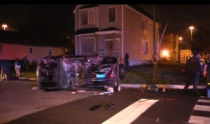 A vehicle rests on its side after a driver lost control while caught in the crossfire of an Englewood shooting. | Network Video Productions