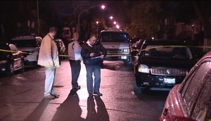Police investigate after a man was shot to death in the 1200 block of West 73rd Place. | Network Video Productions