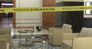 Police investigate after a man was shot to death in a hotel lobby early Saturday near McCormick Place. | Network Video Productions
