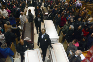 Six caskets of six family members found killed in their Gage Park home on Feb. 4 line the aisle at St. Gall Church, 5511 S. Sawyer, on Sunday night. | Brian Jackson/For the Chicago Sun-Times