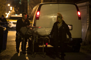 Technicians remove the body of a 19-year-old man who was shot in the head in the 5300 block of South Hermitage early Wednesday. | Ashlee Rezin/Chicago Sun-Times