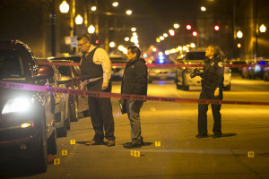 Chicago Police investigate in the 1300 block of South Central Park Avenue, where a 32-year-old man was shot to death early Sunday, April 17, 2016. | Ashlee Rezin/Sun-Times