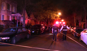 Chicago Police investigate in the 2000 block of West 68th Place late Sunday, where five people were shot, two of them fatally. | Network Video Productions