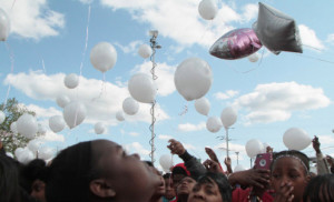 Balloons are released in memory of 15 year old Dekayla Dansberry Sunday in front of New Beginnings Church, 66th and King Dr. during a vigil.  The teenager was fatally stabbed Saturday. | Leslie Adkins/ For the Sun-Times
