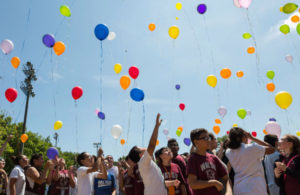 Students from local catholic and public schools release balloons into the sky during June 15 peace rally in McGuane Park. | Lou Foglia/Sun-Times