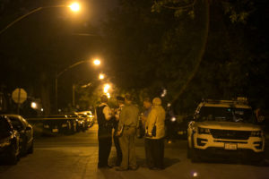 Chicago Police investigate in the 9000 block of South Marshfield, where two men were shot to death on a porch early Sunday. | Ashlee Rezin/Sun-Times