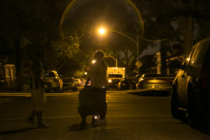 Mourners gather in the 9000 block of South Marshfield after two men were shot to death on a porch early Sunday. | Ashlee Rezin/Sun-Times