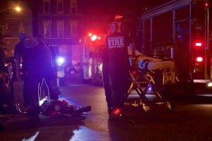 Paramedics attend to a man who was shot in the Pilsen neighborhood early Wednesday morning near Throop and 18th Place. | Matthew Hendrickson/Sun-Times