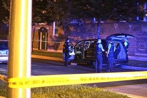 Police look through a van while investigating a fatal shooting early Thursday in Gresham. | Daniel Brown/Sun-Times