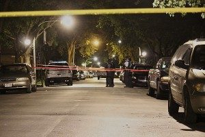 Police investigate a homicide early Sunday in Marquette Park. | Daniel Brown/Sun-Times