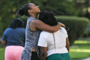 Family members and friends mourn in the 8100 block of South Essex, after a fire in an apartment building killed three children and left three other injured early Tuesday, Aug. 23, 2016. | Ashlee Rezin/Sun-Times