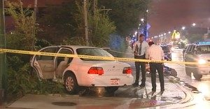 Police investigate the car after two people were shot Friday night in the 3300 block of West North Avenue. | NVP News