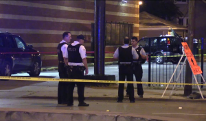 Chicago Police investigate in the 12300 block of South Halsted, where two men were shot to death early Wednesday. | Network Video Productions