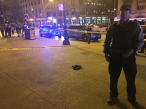 Police investigate a shooting Saturday night at Michigan and Monroe near Millennium Park that sent a man to the hospital, where he died on Sunday. | Jacob Wittich / Sun-Times