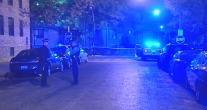 Chicago Police investigate the site where twin brothers were fatally shot early Sunday in the 1300 block of North Hudson. | Network Video Productions
