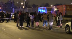 Dozens gather near the scene of two fatal shootings, one involving Chicago Police early Friday in Homan Square. | Network Video Productions