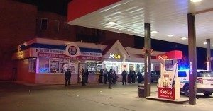 Police investigate after a fatal shooting at a Washington Park neighborhood gas station early Friday. | Network Video Productions