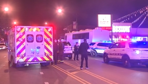 Chicago Police investigate in the 6300 block of North Broadway, where three men were shot early Sunday. | Network Video Productions