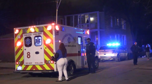 Chicago Police investigate in the 5600 block of South Elizabeth, where two men were shot Saturday night. | Network Video Productions