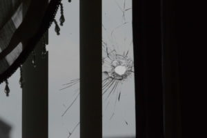 A bullet hole in a window in the 3500 block of West Van Buren on Sunday. | Brian Jackson/For the Sun-Times
