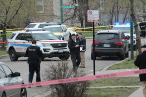 Chicago Police investigate the scene where two men were killed and four men were shot in the at 4:33 p.m. Sunday in the 3500 block of West Van Buren in the East Garfield Park neighborhood on the West Side. | Brian Jackson/For the Sun-Times