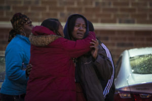 Dana Jackson mourns for her sons Dillon, 20, and Raheam,19, who were shot to death with two others at Nadia Fish and Chicken at 75th and Coles Thursday afternoon, March 30, 2017. | Ashlee Rezin/Sun-Times