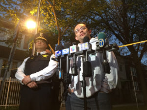 Ald. Raymond Lopez (right) and CHicago Police Dep. Cmdr. Kevin Navarro discuss the recent ooutbreak of violence in the Brighton Park neighborhood, part of a turf war between several different gangs. | Lauren Fitzpatrick/Sun-Times