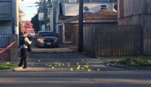 Evidence markers line the street after a shooting Sunday night in Brighton Park that left a brother and sister dead, and 8 other people injured. | Lauren Fitzpatrick/Sun-Times