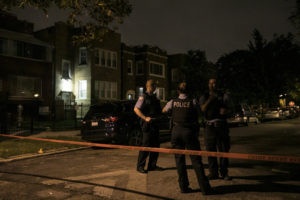 Chicago Police investigate at a home in the 1400 block of North Leclaire in Austin, where a son found his parents stabbed to death early Sunday. | Ashlee Rezin/Sun-Times