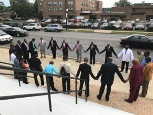 CHurch members take part in a prayer vigil outside Friendship Baptist Church in Austin the day after two men were shot to death on the front steps of the church. | Facebook