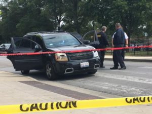 A black SUV is checked by police outside the Cook County Courthouse at 26th and California. The driver stopped there and dropped off a man who had been shot. | Andy Grimm/Sun-Times
