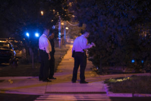 Chicago Police investigate near East 37th Street and South Michigan Avenue, where one man was killed and five women were wounded in a shooting Tuesday night, Aug. 8, 2017. | Ashlee Rezin/Sun-Times