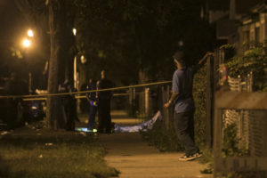 Chicago Police investigate after CHristopher Hardrick was shot to death Tuesday morning in West Englewood. | Ashlee Rezin/Sun-Times