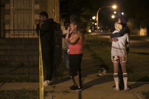 Family members and friends watch as Chicago Police investigate in the 6600 block of South Oakley, where a 28-year-old Christopher Hardrick was shot to death early Tuesday. | Ashlee Rezin/Sun-Times