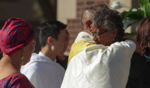 The Rev. Paul Whittington, from St. Margaret of Scotland Church, consoles Vicki McKay after her daughter's funeral Saturday. Simone McKay was a student at Chicago State University. | Leslie Adkins/For the Sun-Times