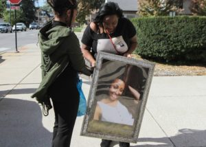 Friends of Simone McKay, Sandra Smith (left) and Jennisha Jones, carry a large photo of Simone McKay before her funeral Saturday. | Leslie Adkins/For the Sun-Times