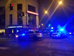 Police investigate a shooting that killed a man and wounded two other people, including a 12-year-old boy, Thursday night at a Starbucks in the Uptown neighborhood. | Nader Issa/Sun-Times