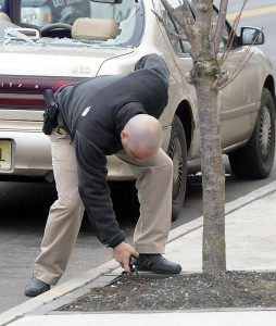 Police look for evidence following a shooting in the 900 block of East State Strret Tuesday Feb. 26, 2013. (Trentonian photo/Jackie Schear)