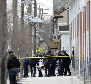Emergency workers move an apparent shooting victim to an ambulance in the 900 block of East State Street in Trenton Tuesday Feb. 26, 2013. (Trentonian photo/Jackie Schear)