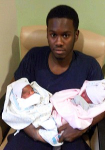 James Austin with his twin daughters.