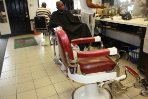The third chair at Mason's Barber Shop, where Trenton homicide victim Rasheen Jones worked for 10 years, now sits empty. (Photo By Ana Ceballos)