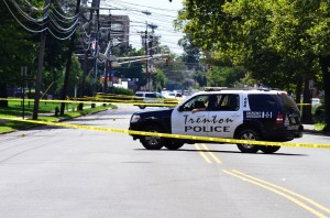 Police investigate the scene of a homicide on Chambers Street where it is believed a man was stabbed multiple times in the stomach. (Trentonian photo/SCOTT KETTERER)
