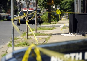 Evidence markers are seen along East State St. near Olden Ave. Sunday Aug. 4, 2013. A Black cloth barrier on the right protects the scene of the crime. (Trentonian photo/Jackie Schear)