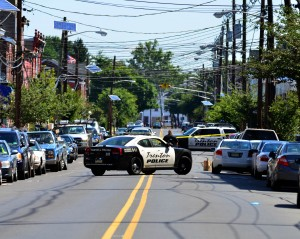 Police block off a section of East State Street on Sunday Aug. 4, 2013 following multiple homicides and a car accident that has left one woman in stable condtion and another fighting for her life at Capital Health Regional Medical Center on Sunday August 4, 2013. (Trentonian photo/SCOTT KETTERER)