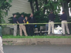 Police investigate murder outside of Candlelight Lounge, June 9, 2014.