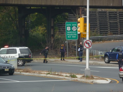 Police investigate a homicide that occurred near Market Street and the Route 1 overpass, Oct. 29, 2014. (Penny Ray - Trentonian)